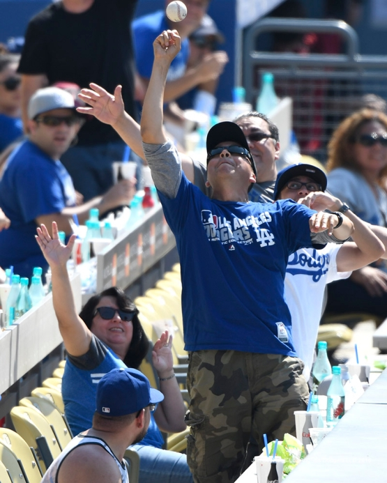 Great catch by Los Angeles Dodgers fan during game against the Arizona Diamondbacks Sunday, July 31,12016 at Dodger Stadium in Los Angeles,California. Photo by Jon SooHoo/©Los Angeles Dodgers,LLC 2016