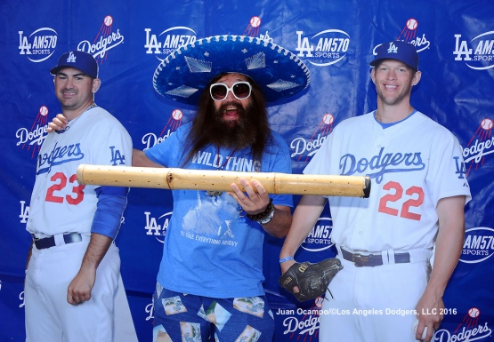 "Vic ""The Brick"" Jacobs, poses for a photo with cutouts of Gonzalez and Kershaw during Viva Los Dodgers before the game against the Diamondbacks at Dodger Stadium."