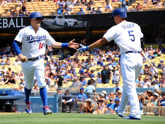 Enrique Hernandez is greeted by Corey Seager after scoring in the fourth inning.