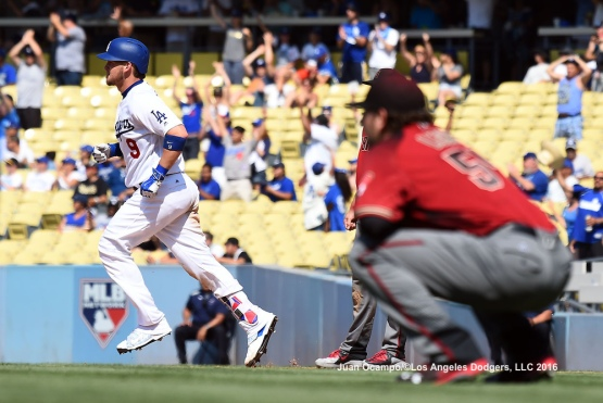 Yasmani Grandal rounds the bases after his three-run homer off of the Diamondbacks' Dominic Leone in the sixth inning.