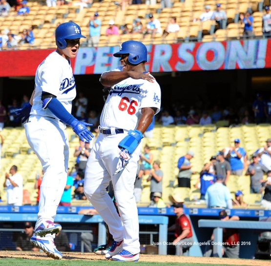 Joc Pederson and Yasiel Puig celebrate Pederson's two-run homer in the eighth inning.