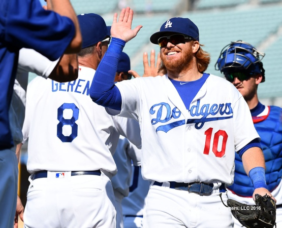 Justin Turner high-fives his teammates after the Dodgers' 14-3 win over the Diamondbacks.