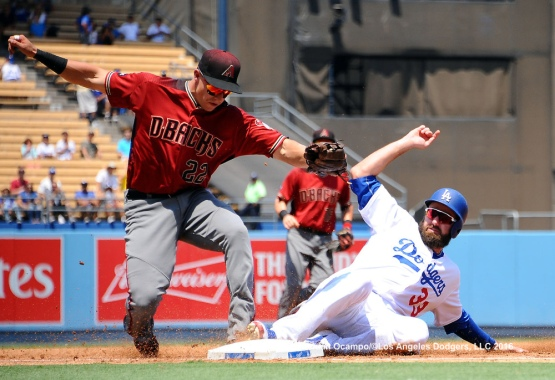 The Diamondbacks' Jake Lamb forces out Scott Van Slyke at third base in the first inning.