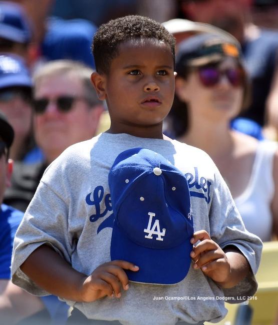 A young fan looks on during the game between the Dodgers and the Diamondbacks.