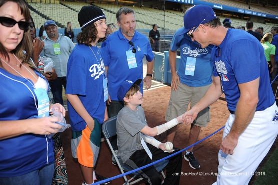 Chase Utley talks to his guests prior to game against the Boston Red Sox Friday, August 5, 2016 at Dodger Stadium in Los Angeles,California. Photo by Jon SooHoo/©Los Angeles Dodgers,LLC 2016