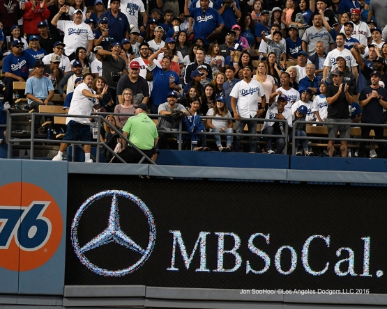 Great Los Angeles Dodger fan returns opponent's home run ball during game against the Boston Red Sox Friday, August 5, 2016 at Dodger Stadium in Los Angeles,California. Photo by Jon SooHoo/©Los Angeles Dodgers,LLC 2016