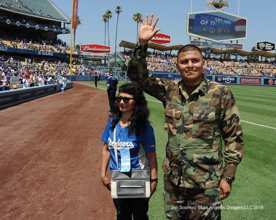 Los Angeles Dodgers Military Hero of the Game, US Army Specialist, Nestor Martinez waves to the crowd during game against the Boston Red Sox Saturday, August 6, 2016 at Dodger Stadium in Los Angeles,California. Photo by Jon SooHoo/©Los Angeles Dodgers,LLC 2016