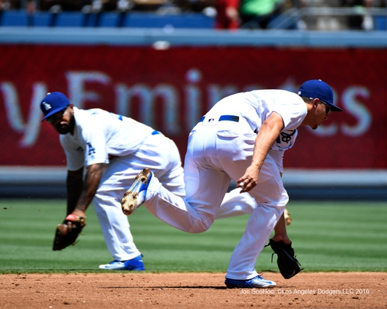 Corey Seager fields ball in front of teammate Howie Kendrick during game against the Boston Red Sox Saturday, August 6, 2016 at Dodger Stadium in Los Angeles,California. Photo by Jon SooHoo/©Los Angeles Dodgers,LLC 2016