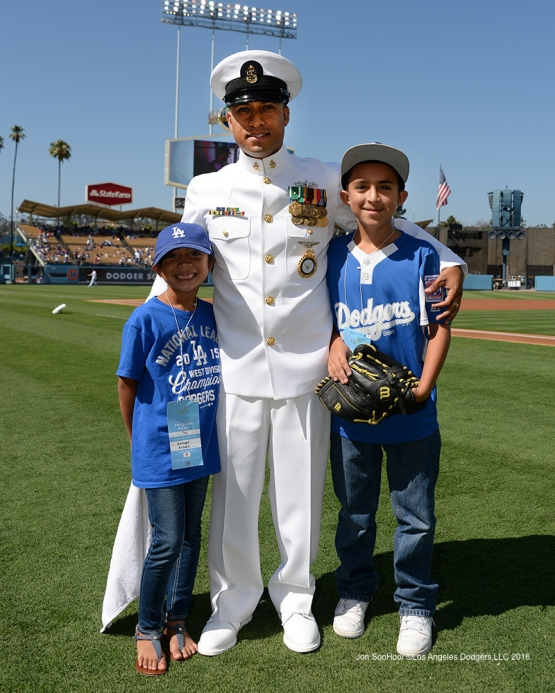 US Navy Chief Petty Officer, Jesse Garcia with kids during the game against the Boston Red Sox Sunday, August 7, 2016 at Dodger Stadium in Los Angeles,California. Photo by Jon SooHoo/©Los Angeles Dodgers,LLC 2016
