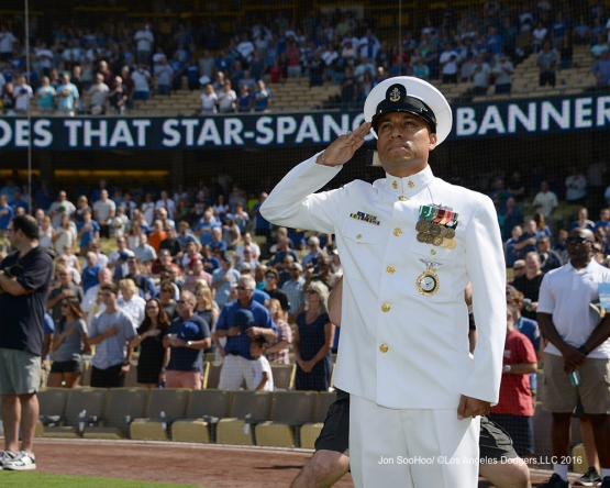US Navy Chief Petty Officer, Jesse Garcia salutes the flag prior to to the game against the Boston Red Sox Sunday, August 7, 2016 at Dodger Stadium in Los Angeles,California. Photo by Jon SooHoo/©Los Angeles Dodgers,LLC 2016