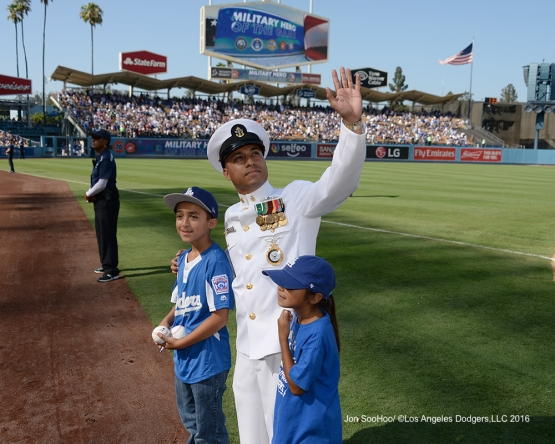 US Navy Chief Petty Officer, Jesse Garcia waves to the crowd during game against the Boston Red Sox Sunday, August 7, 2016 at Dodger Stadium in Los Angeles,California. Photo by Jon SooHoo/©Los Angeles Dodgers,LLC 2016