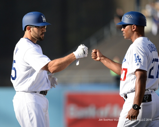 Rob Segedin is greeted by first base coach George Lombard after 2nd hit against the Boston Red Sox Sunday, August 7, 2016 at Dodger Stadium in Los Angeles,California. Photo by Jon SooHoo/©Los Angeles Dodgers,LLC 2016