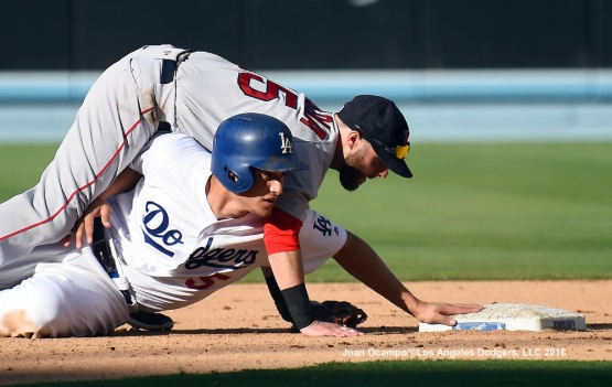 Corey Seager is out at second base as he breaks up the double-play in the fifth inning.
