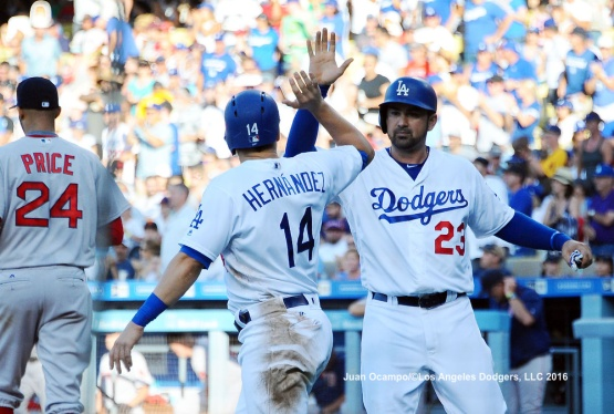 Adrian Gonzalez and Enrique Hernandez high-five each other after scoring in the fifth inning.