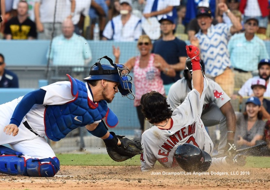Yasmani Grandal stretches to make a play at home on the Red Sox's Andrew Benintendi in the sixth inning.