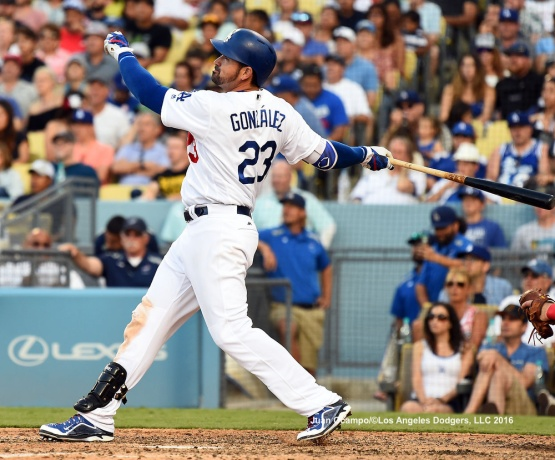 Adrian Gonzalez hits a home run in the seventh inning.
