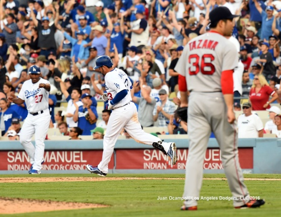 Adrian Gonzalez rounds the bases after hitting a home run off Red Sox reliever Junichi Tazawa.