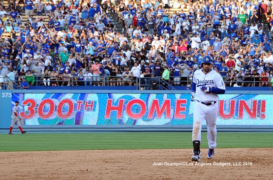 Adrian Gonzalez rounds the bases after hitting his 300th career home run.