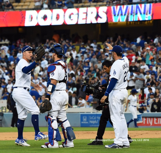 Joc Pederson, Yasmani Grandal and Adrian Gonzalez celebrate the Dodgers 8-5 win over the Red Sox.