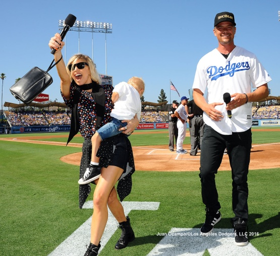 "Josh and Fergie Duhamel, along with their son Axl, take part in ""It's Time For Dodgers Baseball""."