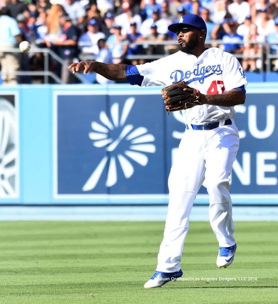 Howie Kendrick makes the throw to second base.