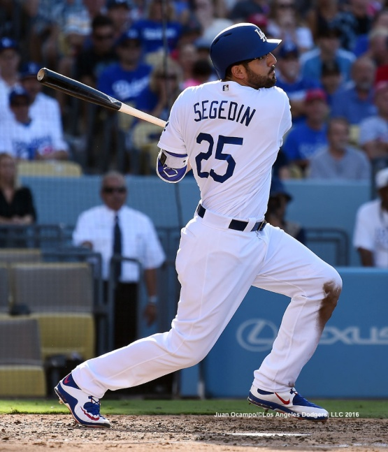 Rob Segedin connects for a double to drive in two runs in the fourth inning.