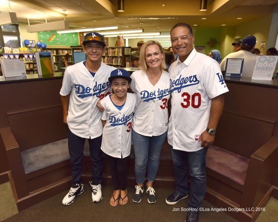 Dodger Manager Dave Roberts and his family read to children at Arroyo Seco Public Library  Monday, August 8, 2016 in Los Angeles,California. Photo by Jon SooHoo/©Los Angeles Dodgers,LLC 2016