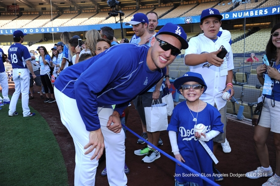 Great Los Angeles Dodger fan Christian Robert Villa poses with Trayce Thompson prior to game against the Philadelphia Phillies Monday, August 8, 2016 at Dodger Stadium in Los Angeles,California. Photo by Jon SooHoo/©Los Angeles Dodgers,LLC 2016
