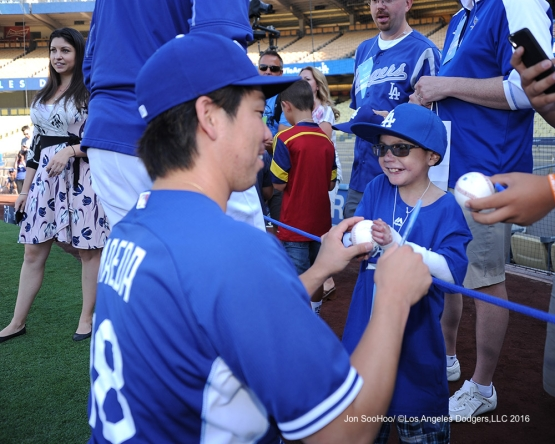 Great Los Angeles Dodger fan Christian Robert Villa talks with Kenta Maeda prior to game against the Philadelphia Phillies Monday, August 8, 2016 at Dodger Stadium in Los Angeles,California. Photo by Jon SooHoo/©Los Angeles Dodgers,LLC 2016