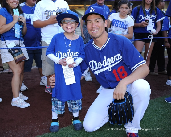 Great Los Angeles Dodger fan Christian Robert Villa poses with Kenta Maeda prior to game against the Philadelphia Phillies Monday, August 8, 2016 at Dodger Stadium in Los Angeles,California. Photo by Jon SooHoo/©Los Angeles Dodgers,LLC 2016