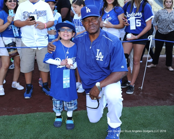 Great Los Angeles Dodger fan Christian Robert Villa poses with Manny Mota prior to game against the Philadelphia Phillies Monday, August 8, 2016 at Dodger Stadium in Los Angeles,California. Photo by Jon SooHoo/©Los Angeles Dodgers,LLC 2016