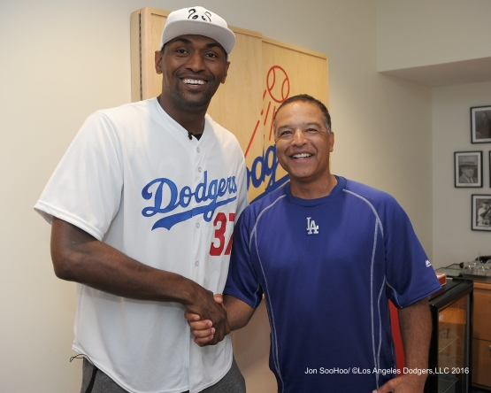 Metta World Peace poses with Dave Roberts prior to game against the Philadelphia Phillies Monday, August 8, 2016 at Dodger Stadium in Los Angeles,California. Photo by Jon SooHoo/©Los Angeles Dodgers,LLC 2016
