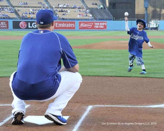 Chritian Robert Villa throws out the first pitch to A.J.Ellis prior to game against the Philadelphia Phillies Monday, August 8, 2016 at Dodger Stadium in Los Angeles,California. Photo by Jon SooHoo/©Los Angeles Dodgers,LLC 2016
