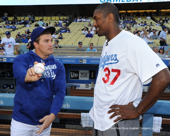 Kike Hernandez with tips for Metta World Peace prior to game against the Philadelphia Phillies Monday, August 8, 2016 at Dodger Stadium in Los Angeles,California. Photo by Jon SooHoo/©Los Angeles Dodgers,LLC 2016