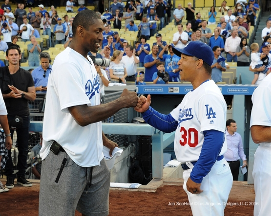 Metta World Peace and Dave Roberts prior to game against the Philadelphia Phillies Monday, August 8, 2016 at Dodger Stadium in Los Angeles,California. Photo by Jon SooHoo/©Los Angeles Dodgers,LLC 2016