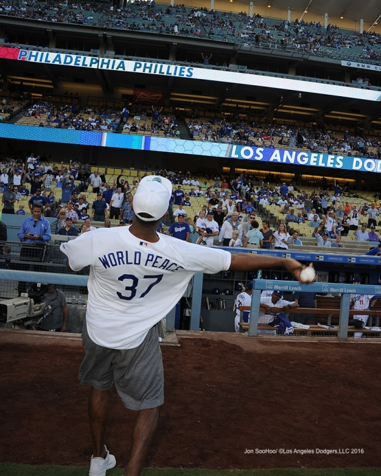 Metta World Peace throws out the first pitch ball to lucky fan prior to game against the Philadelphia Phillies Monday, August 8, 2016 at Dodger Stadium in Los Angeles,California. Photo by Jon SooHoo/©Los Angeles Dodgers,LLC 2016
