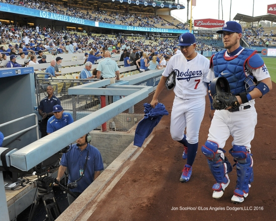 Julio Urias and Yasmani Grandal head to dugout prior to game against the Philadelphia Phillies Monday, August 8, 2016 at Dodger Stadium in Los Angeles,California. Photo by Jon SooHoo/©Los Angeles Dodgers,LLC 2016