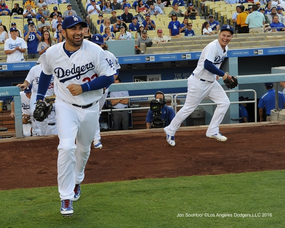 Adrian Gonzalez and Joc Pederson take the field during game against the Philadelphia Phillies Monday, August 8, 2016 at Dodger Stadium in Los Angeles,California. Photo by Jon SooHoo/©Los Angeles Dodgers,LLC 2016