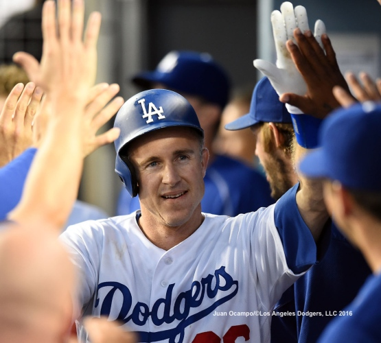 Chase Utley high-fives his teammates after hitting a home run.
