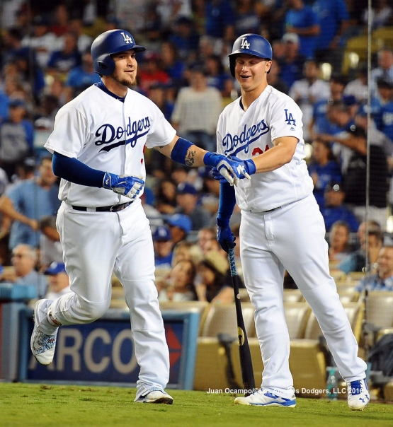 Yasmani Grandal is greeted by Joc Pederson after hitting a home run.
