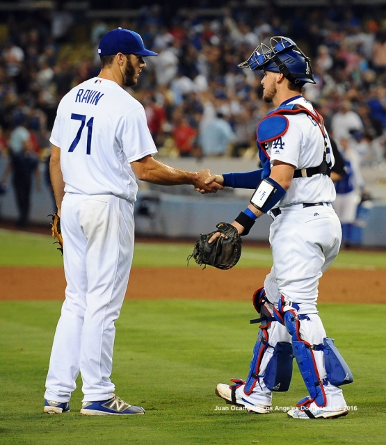 Josh Ravin and Yasmani Grandal celebrate the Dodgers' 9-4 win against the Phillies.