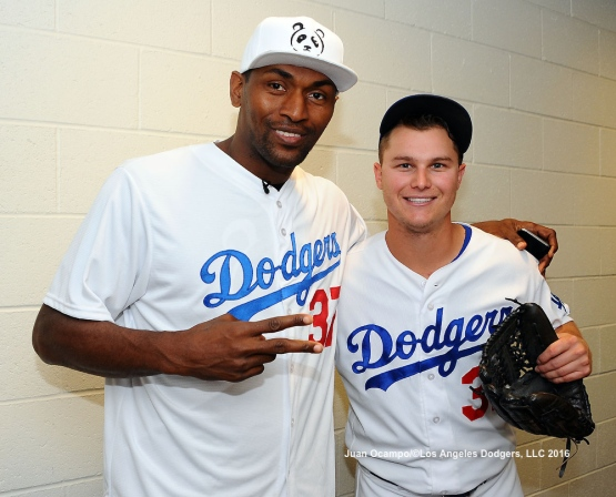 Metta World Peace and Joc Pederson pose for a photo.