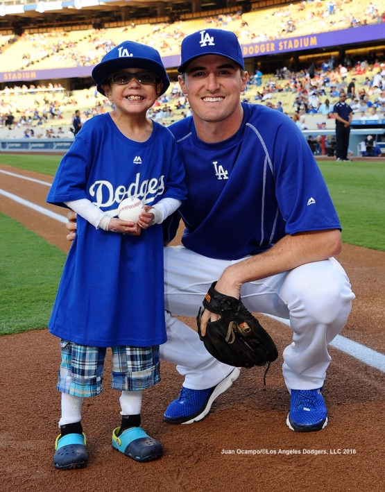 Ross Stripling poses for a photo with Christian Robert Villa from the Dodger Blue Wishes program.