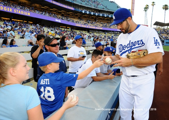 Rob Segedin signs autographs before the game against the Phillies.