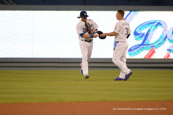 Josh Reddick and Joc Pederson during game against the Philadelphia Phillies Tuesday, August 8, 2016 at Dodger Stadium in Los Angeles,California. Photo by Jon SooHoo/©Los Angeles Dodgers,LLC 2016