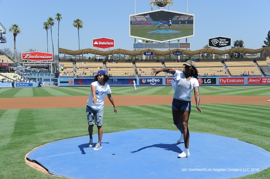 LA Sparks Kristi Tolliver and Jantel Lavender throw out the first pitch prior to   game against the Philadelphia Phillies Wednesday, August 10, 2016 at Dodger Stadium in Los Angeles,California. Photo by Jon SooHoo/©Los Angeles Dodgers,LLC 2016