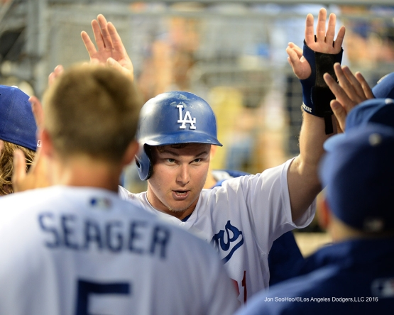 Joc Pederson is greeted by teammates after scoring against the Pittsburgh Pirates Friday, August 12, 2016 at Dodger Stadium in Los Angeles,California. Photo by Jon SooHoo/©Los Angeles Dodgers,LLC
