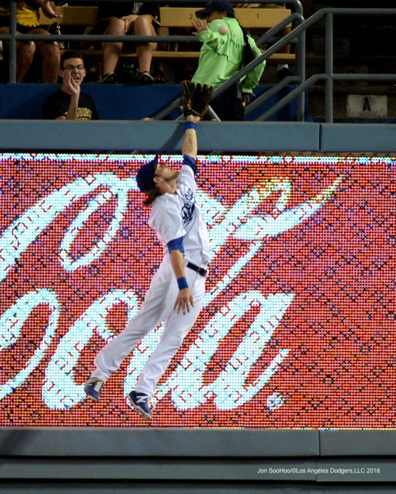 Josh Reddick goes up for ball during game against the Pittsburgh Pirates Friday, August 12, 2016 at Dodger Stadium in Los Angeles,California. Photo by Jon SooHoo/©Los Angeles Dodgers,LLC