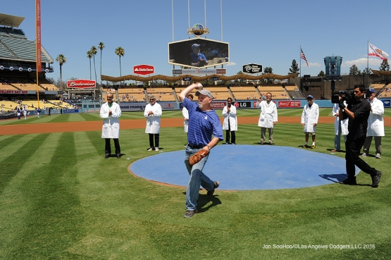 Think Cure Weekend- City of Hope doctor Steven Rosen throws out the first pitch prior to game against the Pittsburgh Pirates Saturday, August 13, 2016 at Dodger Stadium in Los Angeles,California. Photo by Jon SooHoo/©Los Angeles Dodgers,LLC