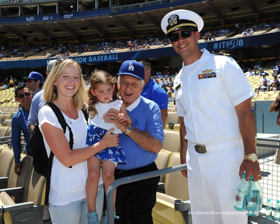 U.S.Navy Lieutenant, Ridge Alkonis and family pose with Tommy Lasorda prior to game against the Pittsburgh Pirates Saturday, August 13, 2016 at Dodger Stadium in Los Angeles,California. Photo by Jon SooHoo/©Los Angeles Dodgers,LLC
